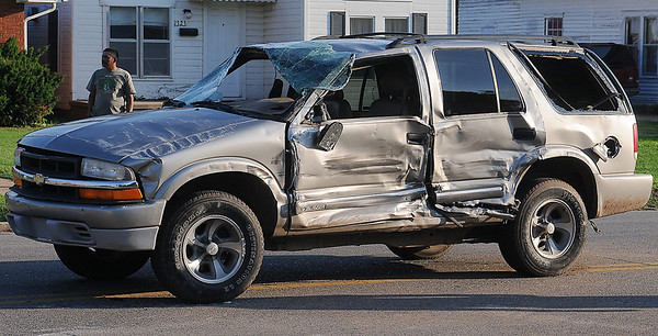 A Chevrolet SUV was rolled when it collided with a Chevrolet 2500 Truck in the 1300 block of East Maine Tuesday, June 10, 2014. The driver of the truck left the scene of the accident before Enid Police officers arrived. Minor injuries were treated as the Enid Fire Department and Life EMS assisted the Enid Police Department. (Staff Photo by BONNIE VCULEK)