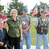 Phil Templin (seated left), a C123 U.S.A.F. pilot during the Vietnam War, and other Vietnam Veterans pause and remember the fallen heroes during the In Memory Celebration Saturday, June 14, 2014. (Staff Photo by BONNIE VCULEK)