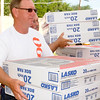 Jay Don Hofen and Troy Cowley, with OG&E, deliver fifty Lasko 20 inch box fans to the Salvation Army in Enid Wednesday, June 25, 2014. OG&E purchased 1,000 for distribution across the state. (Staff Photo by BONNIE VCULEK)