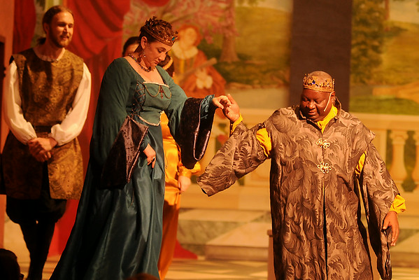 Queen Gertrude, portrayed by Catina Sundvall (left), and King Claudius, played by Venson Fields (right), exit the stage during Gaslight Theatre's 20th anniversary performance of Shakespeare in the Park at Enid Symphony Hall Saturday, June 28, 2014. Due to inclement weather Friday night, the performance was cancelled at intermission and moved to Enid Symphony Center on Saturday. The production was made possible by Park Avenue Thrift, Diane & Jon Ford, Home Sellers Real Estate, The Harris Foundation, Security National Bank of Enid and the Oklahoma Arts Council. (Staff Photo by BONNIE VCULEK)