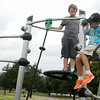 Jayden Goins, Avron Nix and Jonan Nix (from left) play the new game at Meadowlake Park South Thursday, June 26, 2014. (Staff Photo by BONNIE VCULEK)