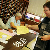Michael Hartling (right) receives his Republican ballot at Precinct 202 inside Redeemer Lutheran Church during the Oklahoma Primary Election Tuesday, June 24, 2014. (Staff Photo by BONNIE VCULEK)
