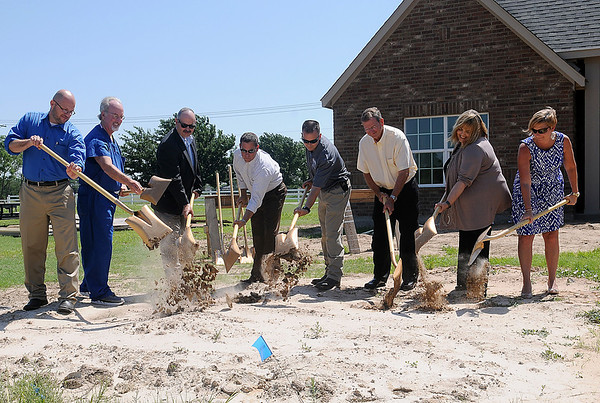 Dignitaries break ground near the phase II expansion site of Tara Estates Wednesday, June 11, 2014. Lance Windell (fourth, from right), with Milestone Homes, announced that the 31 new single family homes in the expansion will be priced at $90 per square foot. (Staff Photo by BONNIE VCULEK)