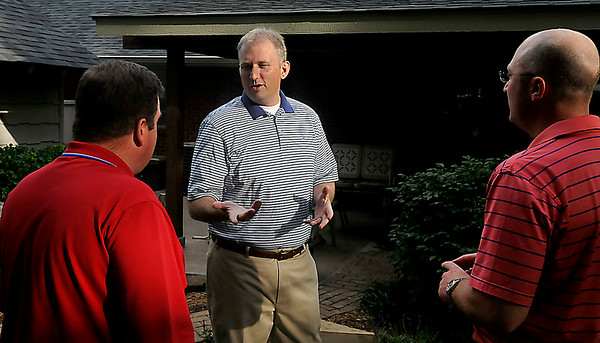 Chad Caldwell visits with Jamey Shepherd and Jimmy Stallings at his Oklahoma House Dist. 40 watch party Tuesday. (Staff Photo by BILLY HEFTON)