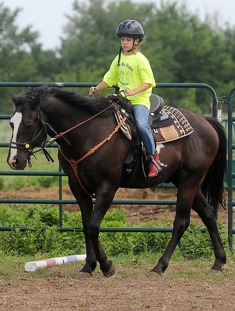 Alex Sabedra uses a soft lead as she trots McTy (My Kid to Yours) around the arena during Enter His Gates summer camp Friday, June 20, 2014. (Staff Photo by BONNIE VCULEK)