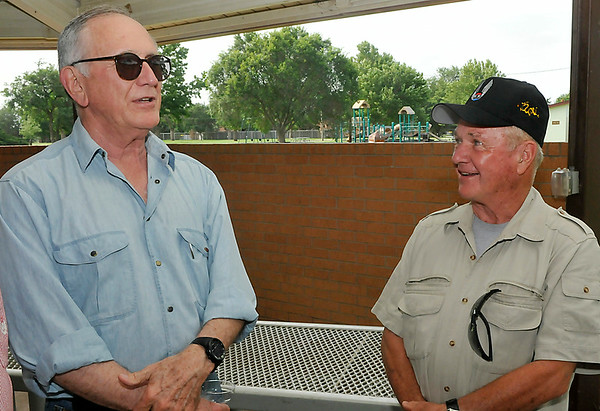 Jerry Ward (left) and Butch Coltrane share stories during an interview the 50th reunion of their pilot training class at Vance Air Force Base. (Staff Photo by BILLY HEFTON)