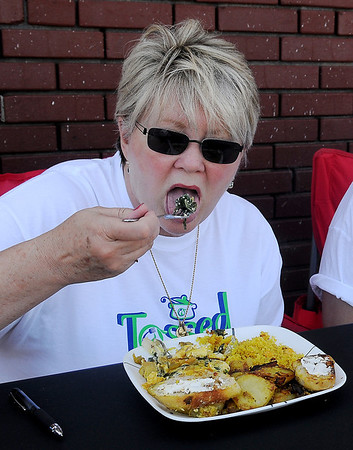 "Barb Benson judges the vegetarian meal prepared by Randy Wedel during the ""Tossed"" challenge at Enid Farmers Market Saturday, June 21, 2014. (Staff Photo by BONNIE VCULEK)"