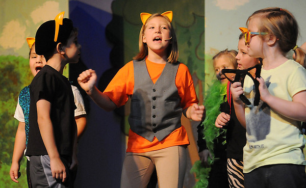"""Brooklyn Phillips (center) portrays Thomas O'Malley as she sings with other alley cats during a rehearsal for Gaslight Theatre's drama camp production of """"Aristocats"""" Wednesday, June 18, 2014. (Staff Photo by BONNIE VCULEK)"""