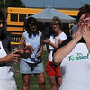 """Ebby Stratton (left) and Kathy Reihm react as Reihm wins the """"Tossed"""" competition at Enid Farmers Market Saturday, June 21, 2014. (Staff Photo by BONNIE VCULEK)"""