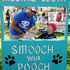 "Dalen, Tess, and Colin McVay spend a few seconds in the Kissing Booth for a ""Smooch Your Pooch"" during Downtown Dogfest on the Garfield County Courthouse lawn Saturday, June 14, 2014. (Staff Photo by BONNIE VCULEK)"