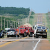 Oklahoma Highway Patrol, Oklahoma Medical Examiner, Grant County Sheriff Department, and rural firefighters respond to the scene of a fatality accident near the intersection of Oklahoma Highways 132 and 11 Wednesday, June 25, 2014. (Staff Photo by BONNIE VCULEK)