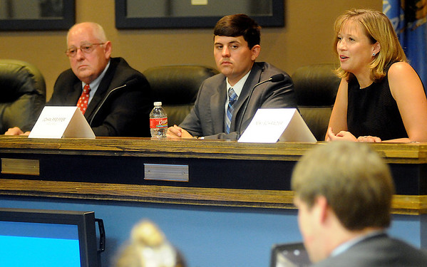 Roy Chaney from Newkirk and John Pfeiffer from Mulhall listen as Niki Schrader from Enid answers a question during the District 38 candidate forum at the City of Enid Commission boardroom Tuesday, June 10, 2014. (Staff Photo by BONNIE VCULEK)