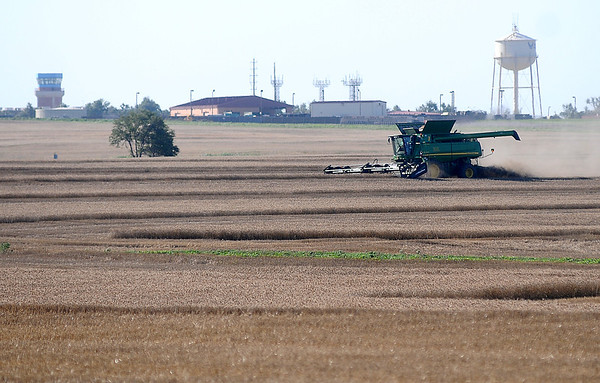 An area farmer harvests his wheat near Vance Air Force Base Saturday, June 14, 2014. After several rain delays, harvest has resumed in Garfield County. (Staff Photo by BONNIE VCULEK)