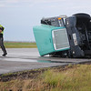 The Oklahoma Highway Patrol investigates the scene of an overturned semi-truck 1.5 miles south of Bison on U.S. 81 Thursday, June 12, 2014. OHP and Garfield County Sheriff Department immediately closed both lanes of the southbound traffic, then reopened the inside lane after the driver of was transported to a local hospital. Stanley's Wrecker Service assisted with the truck removal. (Staff Photo by BONNIE VCULEK)