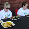 "Barb Benson and Kayte Anton (from left) select the winning dish during the first ""Tossed"" competition at Enid Farmers Market Saturday, June 21, 2014. Vegetarian meals (from left) were prepared by Ebby Stratton, Randy Wedel and Kathy Reihm with Reihm's dish winning the first ""Tossed"" contest. (Staff Photo by BONNIE VCULEK)"