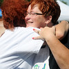 "Kathy Reihm receives a hug from Amy Swanner after Reihm wins the ""Tossed"" vegetarian meal competition at Enid Farmers Market Saturday, June 21, 2014. (Staff Photo by BONNIE VCULEK)"