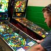 Tim Larsen plays a pinball machine at the Q Spot June 11, 2015. (Staff Photo by BILLY HEFTON)