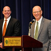 Cory Moore (left) smiles as Ernie Currier addresses the audience after being named the Greater Enid Chamber of Commerce's Citizen of the Year Thursday June 16, 2016 during the Chamber's annual meeting & banquet at the CNB Center. (Billy Hefton / Enid News & Eagle)