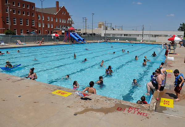 People cool off in Champlin Pool Thursday June 16, 2016 as the Mesonet site at Breckinridge recorded another 100 degree day. (Billy Hefton / Enid News & Eagle)
