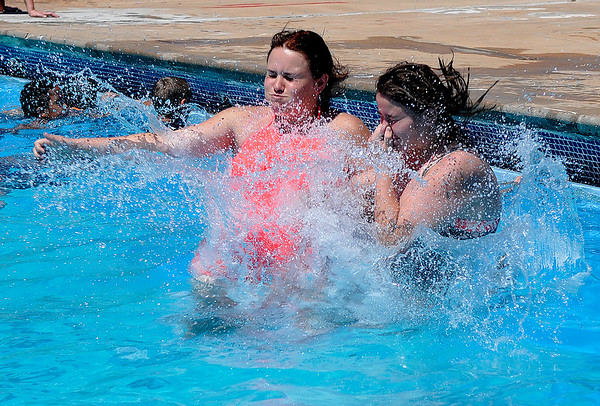 Bella Seckman and Aurora King jump into Champlin Pool together Thursday June 16, 2016. The Mesonet site at Breckinridge recorded a second consecutive 100 degree day.(Billy Hefton / Enid News & Eagle)