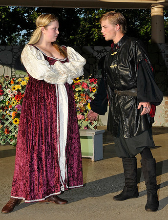 "Jake Taylor and Tori Plunckett rehearse a scene from the Gaslight Teens production of William Shakespeare's ""The Taming of the Shrew"" Tuesday June 21, 2016 at Government Springs Park. (Billy Hefton / Enid News & Eagle)"
