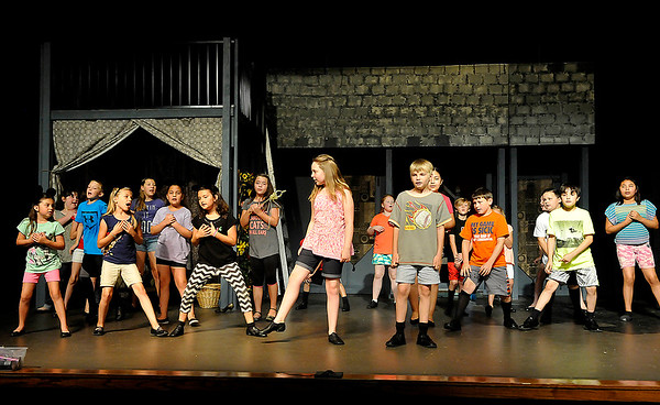 Youths rehearse for the Gaslight Theatre's Kids' Drama Camp production of Disney Kids Cinderella Wednesday June 22, 2016. (Billy Hefton / Enid News & Eagle)
