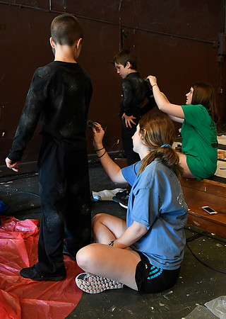 "Brenna Bushman and Madi Wilson paint cast members costumes for the Gaslight Kids' Drama Camp production of the ""Lion King Kids"" at the Gaslight Theater. (Billy Hefton / Enid News & Eagle)"