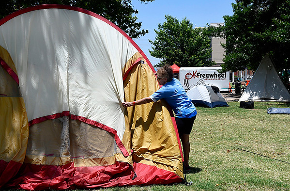 Becky Scarborough, of Tulsa, sets up her tent at Government Springs Park Thursday June 15, 2017. Scarborough is one of the cyclist taking part in Ok Freewheel who spent the night in Enid. (Billy Hefton / Enid News & Eagle)