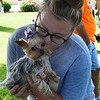 Roxy gets a kiss from Anna Boyd in the kissing booth at the Downtown Dogfest on the Garfield County Courthouse lawn Saturday June 17, 2017. (Billy Hefton / Enid News & Eagle)