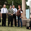 "Ben Ezell (right) and Mona Campbell (kneeling) rehearse for the Shakespeare in the Park production of ""Titus Andronicus"" Tuesday June 20, 2017 at Government Springs Park. (Billy Hefton / Enid News & Eagle)"