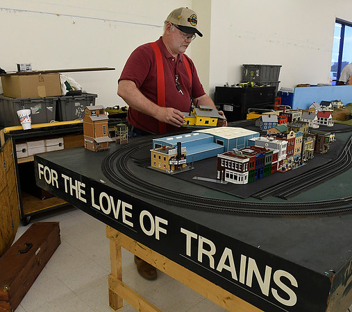 Bill Buxton sets up a display for the CSMRA Trainfest to be held this weekend at Oakwood Mall. The show will be open Saturday June 10 9 a.m. - 3 p.m. and Sunday June 10 a.m. - 3 p.m. (Billy Hefton / Enid News & Eagle)