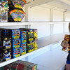 Kamryn Theilen stocks shelves at the fireworks stand operated by Central Assembly of God Church just west of the intersection of Garland and Willow Thursday June 22, 2017. (Billy Hefton / Enid News & Eagle)