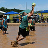J.J. Jackson of the 50 Shades of Mud team returns the ball during the Miracle League Mud Volleyball Tournament Saturday June 24, 2017. (Billy Hefton / Enid News & Eagle)