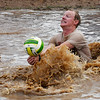Gibson Rose falls as he returns a ball during during the Miracle League Mud Volleyball Tournament Saturday June 24, 2017. (Billy Hefton / Enid News & Eagle)