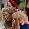 Jeanice Manning and April Cardwell of the Tough Mudders share a laugh during the Miracle League Mud Volleyball Tournament Saturday June 24, 2017. (Billy Hefton / Enid News & Eagle)
