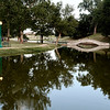 Objects reflects offf the calm water of Government Springs Park Tuesday June 20, 2017. (Billy Hefton / Enid News & Eagle)