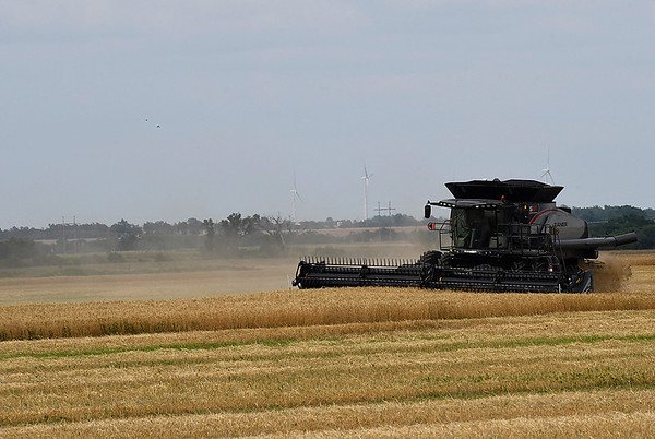 A combine harvest a field north of Fairmont Friday June 2, 2017. (Billy Hefton / Enid News & Eagle)