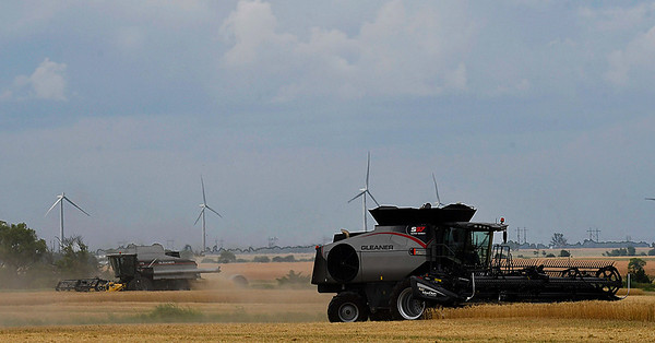 Combines harvest a field north of Fairmont Friday June 2, 2017. (Billy Hefton / Enid News & Eagle)