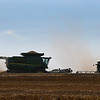 Combines harvest a wheat field on north 54th street Wednesday June 7, 2017. (Billy Hefton / Enid News & Eagle)