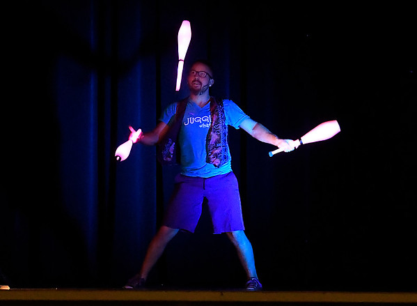 Jeremy Philo, of Juggle Whatever, performs during the Public Library of Enid and Garfield Couty's Summer Reading Program Wednesday June 6, 2018 at the Central National Bank Center. (Billy Hefton / Enid News & Eagle)