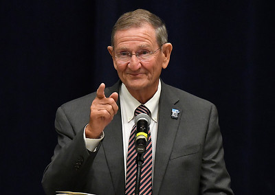 Enid mayor, Bill Shewey, gestures towards his family as he thanks them during his speech after being named the Greater Enid Chamber of Commerce Citizen of the Year during an annual meeting and banquet Tuesday June 12, 2018 at the Central National Bank Center. (Billy Hefton / Enid News & Eagle)