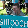 Jared Sturdivant takes a photo with Rowdy during the Downtown Dogfest Saturday June 16, 2018 on the Garfield County Courthouse lawn. (Billy Hefton / Enid News & Eagle)