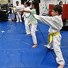 Students take part in class at the Humanitarian School of Martial Arts Wednesday June 20, 2018. (Billy Hefton / Enid News & Eagle)