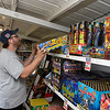 Matt McMullen straightens shelves at a fireworks stand operated Central Assembly Church at the northwest corner of the intersection of Garland and Willow Monday June 25, 2018. The stand is open Monday-Saturday 10 a.m. to 10 p.m. and Sunday 1 p.m. to 10 p.m. (Billy Hefton / Enid News & Eagle)