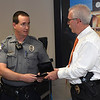 Enid police officer, Roberto Norton, receives his sergeant's badge from Chief Brian O'Rouke Thursday June 27, 2018 at the Enid Police Department. (Billy Hefton / Enid News & Eagle)