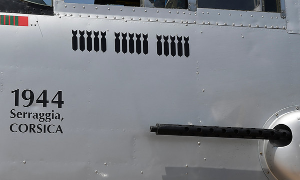 """Bombs painted on the B-25 Mitchell Bomber """"Maid in the Shade"""" representing the 15 bombing missions th eplane flew during World War II. (Billy Hefton / Enid News & Eagle)"""