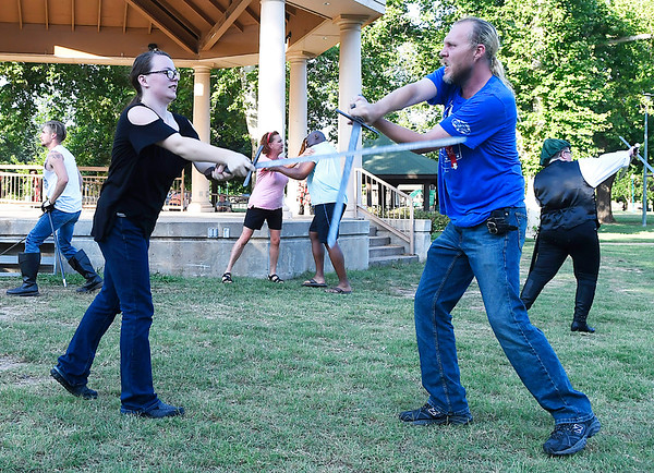 Jasmine Crase and Jeramie Tipton rehearse a fight scene for the Gaslight Theatre Shakespeare in the Park's Romeo and Juliet Friday June 15, 2018. (Billy Hefton / Enid News & Eagle)