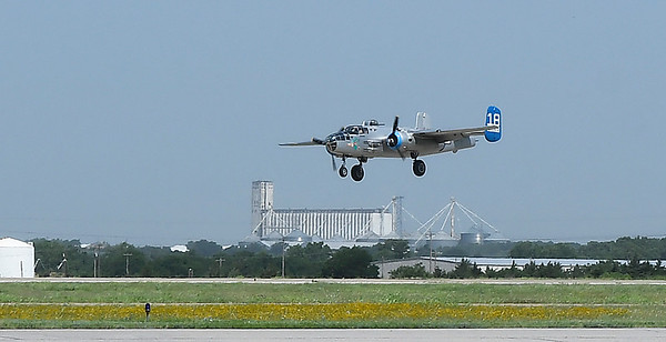 "The B-25 Mitchell Bomber ""Maid in the Shade"" lands at Woodring Airport Monday June 11, 2018. The plane flew 15 bombing missions during World War II. (Billy Hefton / Enid News & Eagle)"