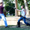 Jerrod Hardy (left) and Lane Gavitt rehearse a fight scene for the Gaslight Theatre Shakespeare in the Park's Romeo and Juliet Friday June 15, 2018. (Billy Hefton / Enid News & Eagle)