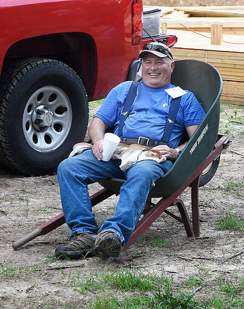 Keith Limke, from Yukon, finds a seat during a break while volunteering for World Mission Builders to build a house on west Randolph Monday, June 3, 2019. (Billy Hefton / Enid News & Eagle)